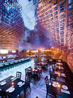 Bluarch's 2,500-square-foot Innuendo restaurant in Port Washington, New York, incorporates a color-changing maple ceiling installation and cherry wall veneer.