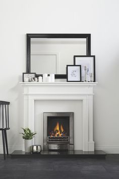 Complement monochrome living with a sleek chrome electric fire and white surround. Complement monochrome living with a sleek chrome electric fire and white surround. Room, Home Living Room, Room Design, House, Home, White Fireplace, Fireplace Design, Monochrome Living Room, New Living Room