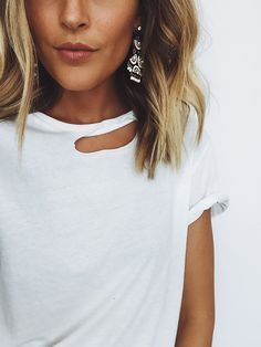 Great white short sleeve you can throw on, love the added flare with the rip on the collar bone! Such a cute top!