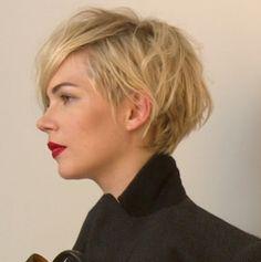 Feminine a-symmetrical under cut and soft vanilla blondes.