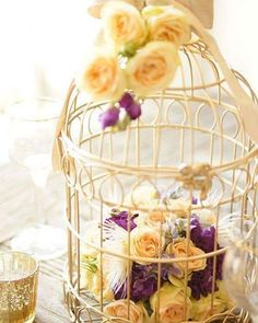 Raindrops and Roses Bird Cage Centerpiece, Diy Centerpieces, Raindrops And Roses, Wedding Decorations, Table Decorations, Wedding Ideas, Bird Cages, Wedding Rentals, Purple Yellow