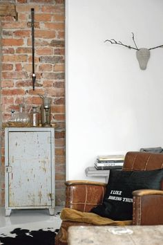 Mix of: brick, leather, cowhide, white walls, painted piece, simple art <3
