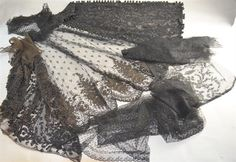 Victorian dress panel extensively beaded in French jet, two 1920`s beaded dress panels two lace mourning veils and a flounce all black lace PROVENANCE; From a collection formerly kept at Hampton Court Palace