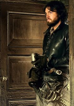 Tom Burke as Athos in the musketeers