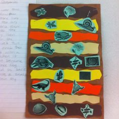 """Sedimentary rock stories -- Students created their own sedimentary rocks (with """"fossils""""). As a writing extension they wrote a story to go with their rock layers."""