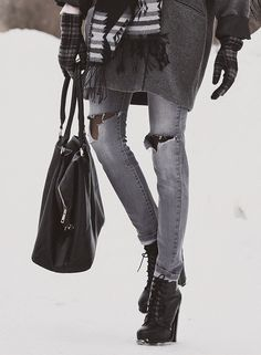 Grey outfit ideas: Tanya is wearing a pair of ash grey ripped skinny jeans