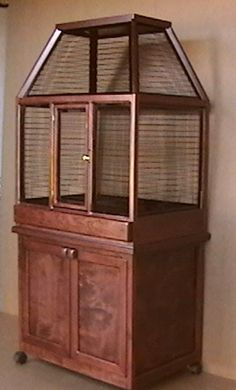 Large bird cage and designer bird cages in Oak and Cherry Wood $1148