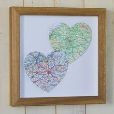 A warm and wonderful hand-made gift particularly befitting a wedding or anniversary perhaps? For friends overseas? Or simply to indulge yourself! Simply choose two locations that hold special meaning by your loved one and we'll source the vintage maps to create a unique, bespoke artwork.    Our frames are also hand-made using limed wood, making this a perfect personalised gift for someone special or a treasured vintage accessory for your own home.    Unframed: 24 x 24cm  Framed: 29 x 29cm…