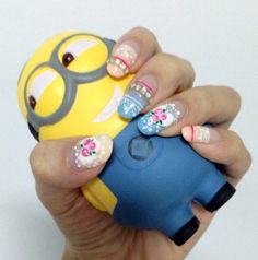 """Newly done nails with my cute minion """"stress ball""""  p(^_^)q"""