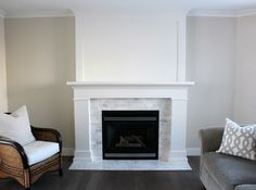 Ideas for fireplace Our white fireplace makeover is officially done! Find out how we used inexpensive trim, white dove paint and marble subway tile to give it a fresh new look. Subway Tile Fireplace, Fireplace Tile Surround, Fireplace Update, Fireplace Hearth, Marble Fireplaces, Fireplace Remodel, Fireplace Surrounds, Fireplace Design, Fireplace Ideas