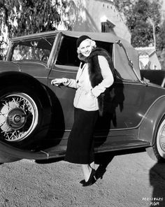 Jean Harlow with her Cadillac cabriolet