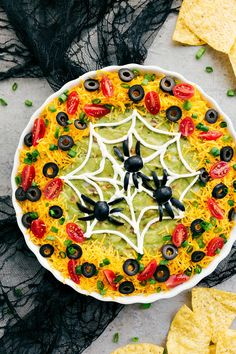 Four easy, & creative Halloween appetizers that are so delicious -- Spiderweb 7-Layer Dip, Walking Dead Mummy Dogs, Monster Meatball Sliders, & Cheesy Monster Fingernail Bread. chelseasmessyapron.com