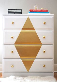 Dressed Up Dresser - 20 Wonderfully Inventive DIY Projects. There are some adorable ideas on this site! Love the gold nobs on the dresser.