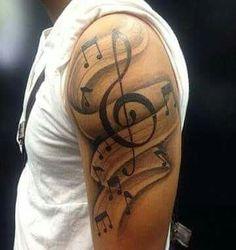 Tatuagem de notas musicas com partituras no estilo sombreado, realizada no Rafa Ferrari tattoo studio feita por Rodrigo de Azeredo. Tattoo of musical notes with scores in shaded style, performed in the Rafa Ferrari tattoo studio made by Rodrigo de Azeredo.