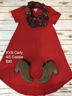 Lularoe outfit of the day: Carly dress paired with a gorgeous Cassie as a scarf. Love this paired together!Top it off with a pair of booties and your set to go.   #lularoe #ootd #womensfashion #springoutfit #cuteoutfits #patterns #carly #cassie
