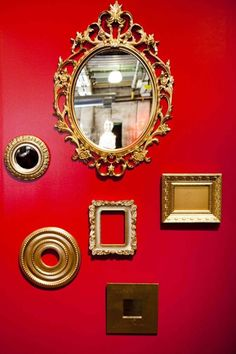 red walls. gold mirrors.
