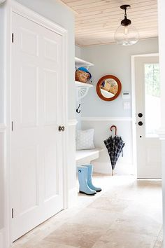 mudroom sarah richardson; chair rail dividing two colors light blue and grey. Nice unexpected combo with warm beige floor and ceiling.