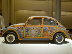 Huichol art on wheels exhibited in BOZAR Brussels in February 2013. 2.277.000 pearls on a VW beetle based on a local Mexican craft.
