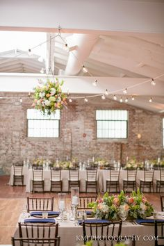 Light-filled reception venue at Bakery 105 in Wilmington, North Carolina. See more of this gorgeous space at www.wilmingtonweddingsandevents.com