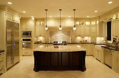 101 U-Shape Kitchen Layout Ideas (Photos) - This U-shaped kitchen centers around a large dark wood island with classic marble countertop. Surrounding counters in black, with white cabinetry, add contrast. Luxury Kitchen Design, Luxury Kitchens, Cool Kitchens, Kitchen Designs, Kitchen Ideas, Kitchen Decor, Custom Kitchens, Dream Kitchens, White Kitchens