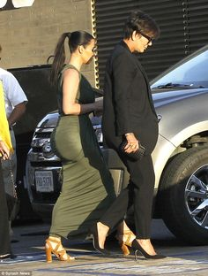 Looking booty-ful! Kim Kardashian wears typically figure-hugging dress #dailymail
