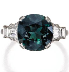 Platinum, Alexandrite and Diamond Ring, Raymond Yard, Circa 1925. The cushion-cut alexandrite weighing approximately 4.50 carats, flanked by four trapezoid-shaped diamonds and 16 round diamonds, signed Yard. #Yard #ArtDeco #Alexandrite #ring