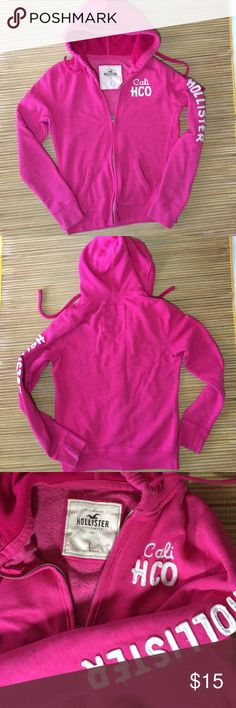 Hollister hoodie sweat jacket in bright pink Super soft and comfy. Preloved hollister hoodie zips up with drawstring at hood. Small own mark on underside of right wrist cuff see last pic. Also some stitching wear in line with some use. Good condition overall. Hollister Jackets & Coats