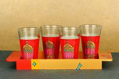 "Hand Painted wooden tray with a set of 4 hand painted glasses. Product name: ""Sharbat Glasses - Moroccan Lamp"" #sharbat #makeinindia #glassware #artisans #Moroccan Know more - www.akrazymug. com"