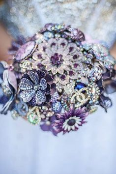 Use of broaches to make bouquets or all sizes, colors, and styles including some with fresh/silk flowers.  David Tuttera did this for a few of his brides, not the whole bouquet, but just a touch of bling.  #WeddingTrends2013