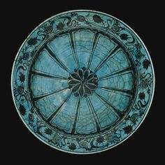 A TURQUOISE-GLAZED KUBACHI DISH, PERSIA, 16TH/17TH CENTURY