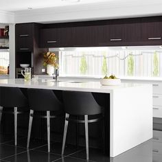 The Empire #Barstool is dark and dramatic in this contemporary #kitchen #CocoRepublic #interiordesign #home #style