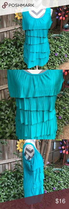 Teal ruffled top This top is NWOT. So comfy and stretchy!! Dress up or down!! Very flattering. You will love it. Studio y Tops Blouses