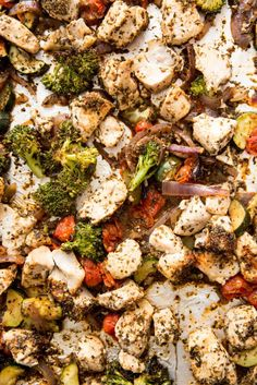 Italian Chicken: Brown rice, zucchini, broccoli, tomatoes, onion and seasoned chicken, all cooked on a sheet pan for big flavor, meal prep!