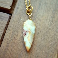 This dagger necklace will protect you on your travels. My Lady's Dagger jasper necklace @sneakpeeq.com
