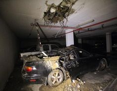 Hamas rockets reach the north, Abbas charges Israel with genocide - July Image -Damage caused by a missile strike in Ashdod on July (photo credit: AFP/DAVID BUIMOVITCH) Gaza Strip, Israel News, News Around The World, International News, Palestine, Rockets, David, Middle East, Photo Credit