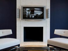 Modern Fireplace Design Inspirations - White Marble Fireplace with wall-mounted television Above Fireplace Ideas, Tv Over Fireplace, White Fireplace, Modern Fireplace, Fireplace Design, Corner Fireplaces, Fireplace Facade, Concrete Fireplace, Navy Living Rooms