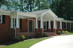 Full front porch addition on a ranch style home - designed and built by Georgia Front Porch. http://www.georgiafrontporch.com/porches/gallery/