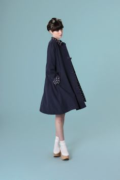 Swing Swing in the Polka Detail Swing Coat Navy .. it also comes in pretty Coral http://www.thewhitepepper.com/collections/new-in/products/polka-detail-swing-coat-navy