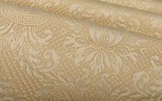 Madame Damask Fabric in Sand is a cream, textured, Italian cotton blend perfect for upholstery projects or custom bedding and pillows. This neutral base has a beautiful intricate damask pattern embroidered throughout, adding the perfect amount of luxury.
