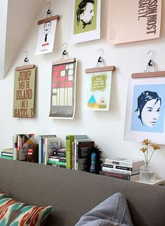 what a good idea.wooden hangers to display Kids' artwork!