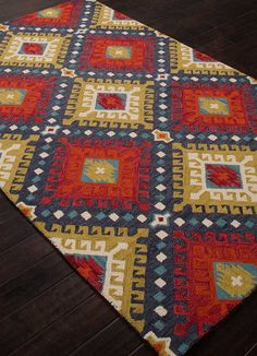 This jewel tone hand tufted area rug will add a splash of color to any southwestern or western room. 100% wool. Pile height 2/9 in.