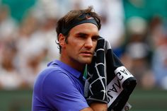 Roger Federer of Switzerland in action during his Men's Singles match against Alejandro Falla of Colombia on day one of the 2015 French Open at Roland Garros on May 24, 2015 in Paris, France.