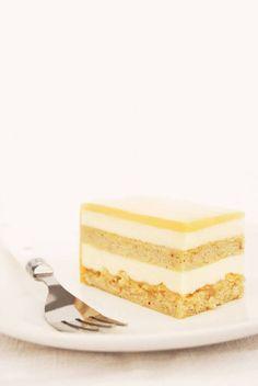 Coffee, hazelnut, and caramel entremet cake with layers of hazelnut cake, coffee mousse, crispy caramelized hazelnuts, and butterscotch glaze. Click for the recipe!