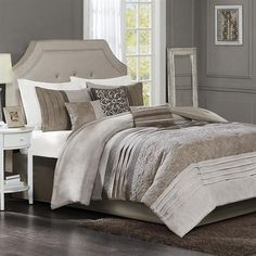 Delicate details come together in this Morgantown 7 Piece Comforter Set by Madison Park. The bottom half of the comforter features a beautiful embroidered pattern that is pieced together with pleated panels of brown and tan micro suede fabric. The same tonal brown panels and pleats are also featured on the shams, drawing subtle attention to the top half of this set. Pulling in the look together are the three decorative pillows that come in a combination of embroidery and pattern design…