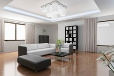 Minimalist living room design with white and black furniture, wood floor and small black coffee table