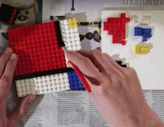 Painting, with Lego! The resulting painting is a recreation of Composition  II in Red, Blue, and Yellow by Piet Mondrian The music used in the  background is the second movement from Schubert's Symphony No.5 in B flat  major.