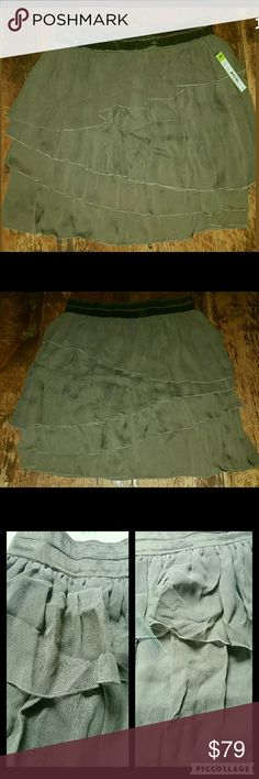 """Alice + Olivia Asymmetric Ruffled Tier Gauzy Skirt Bnwt  $297 A+O skirt ..**there are a few snags/runs, imo not terribly noticeable , PLS SEE PIC #3 to make ur own determination,** Otherwise EXC UNWORN CON! TAGS ATTACHED, Color on tag ARMY  SILK FABRICATION,  TIERED W/ASYMMETRICAL LAYERS ,  fabrication is gauzy crinkled as well as satin-like feeling silk material.  Pls c pic of tag  Shell 100%silk Lining 97 poly/3 spandex Combo 95 silk/5 spandex  Waist 15"""" unstretched .(will stretch several…"""