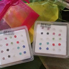 Nose piercings - Sterling silver posts. 40 total 22g Nose and or nail piercings with straight sterling silver posts 925. What you see in pictures are the last two sets I have -  a total of 40!  These are dainty little flowers in several colors.   New in boxes ,sterile ( never used) and come in 2 colorful pouches.  Thanks for looking! 925 Sterling silver   Jewelry