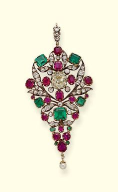 ANTIQUE DIAMOND, RUBY AND EMERALD PENDANT  Of openwork drop-shaped design, the central light yellow cushion-cut diamond within ruby, emerald and diamond surround to the pearl drop and diamond line suspension loop, adapted, mounted in silver and gold, early 19th century,