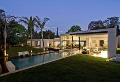 Swimming Pool and Garden in Remodel of a 1950 House in South Africa by Nico van der Meulen Architects